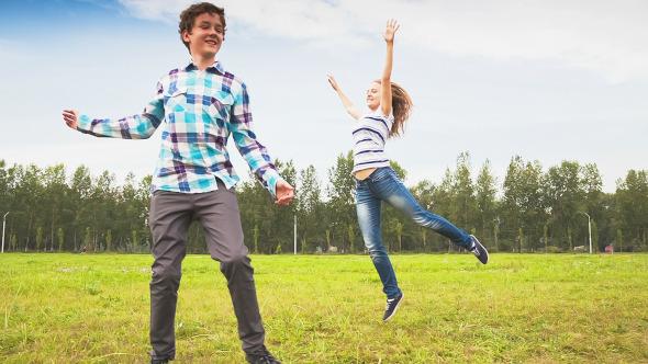 Teens Having Fun on the Meadow