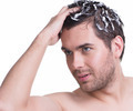 Portrait young handsome man washing hair. - PhotoDune Item for Sale