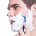 young man shaving the  beard with the razor - PhotoDune Item for Sale
