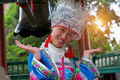 Chinese girl in national dress in Lijiang near old bell - PhotoDune Item for Sale