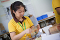 woman packing product on factory in China - PhotoDune Item for Sale