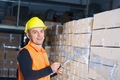 positive young storekeeper at work in warehouse - PhotoDune Item for Sale