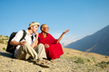 Tibetan monk discuss with European tourist in mountain - PhotoDune Item for Sale