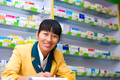 pretty asian pharmacist in drugstore - PhotoDune Item for Sale