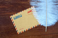 feather and envelope on the table - PhotoDune Item for Sale