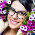 Happy young girl with flowers - PhotoDune Item for Sale