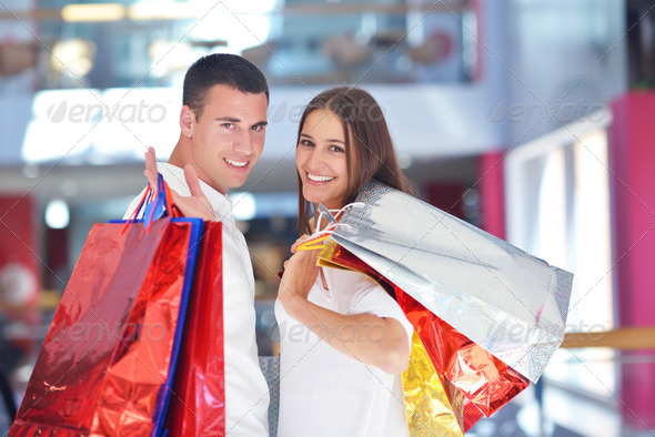 happy young couple in shopping - Stock Photo - Images