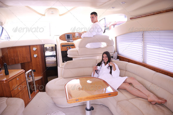 young couple on yacht - Stock Photo - Images