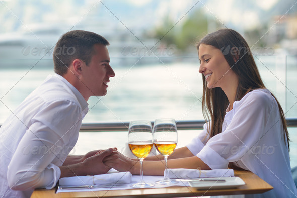 couple having lanch at beautiful restaurant - Stock Photo - Images