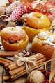 Christmas background of Homemade baked stuffed apples and spices