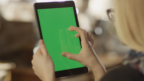 Girl Using Tablet with Green Screen 1