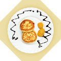 Dish of pancakes with dried apricot on white plate. - PhotoDune Item for Sale
