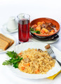 Still life of setout table with soup in ceramic pots, rice and glass of juice. - PhotoDune Item for Sale