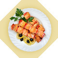 Dish of salmon fish on skewer on white plate. - PhotoDune Item for Sale