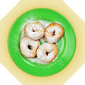 Green dish with donuts, coated with powdered sugar - PhotoDune Item for Sale