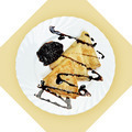 Dish of crepes with chokolate sause on white plate. - PhotoDune Item for Sale