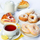 still life of setout table with baking pies, donuts, tee cup and pot. - PhotoDune Item for Sale
