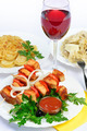 table with food of meat on skewer, dumplings and gass of red wine. - PhotoDune Item for Sale