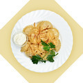 Dish with dumplings on white plate. Isolated image. - PhotoDune Item for Sale