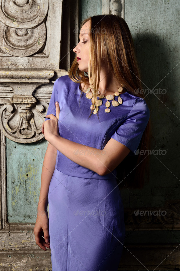 portrait of the beautiful woman blue long gown. - Stock Photo - Images
