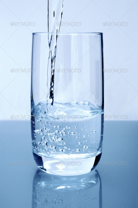 Pouring water - Stock Photo - Images