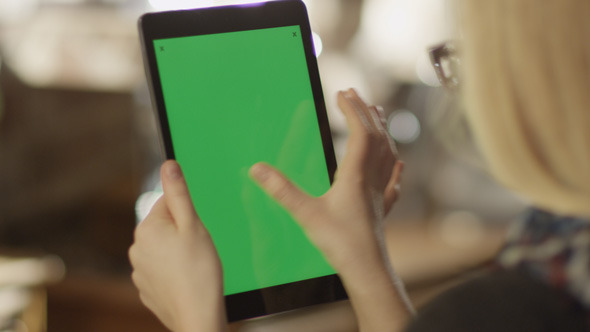 Girl Using Tablet with Green Screen 2