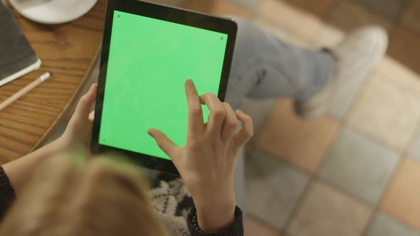 Girl Using Tablet PC with Green Screen 8