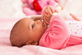 Adorable little african american baby girl playing with a plush