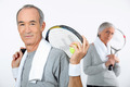 Older couple with tennis rackets - PhotoDune Item for Sale