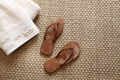 Flip flops with towels on sea grass rug - PhotoDune Item for Sale
