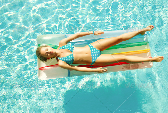 Girl in swimming pool - Stock Photo - Images