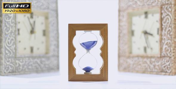 Hourglass And Wall Clocks