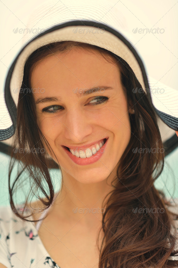 portrait of happy young woman on beach - Stock Photo - Images