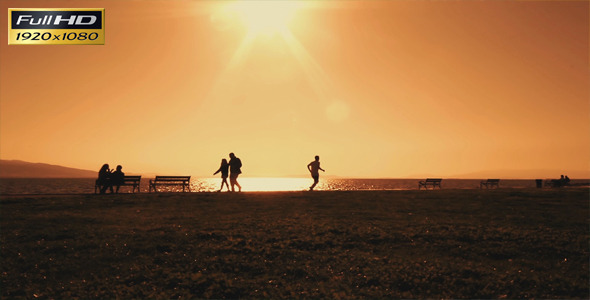 Sunset And Human Silhouettes