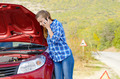 Young woman near broken car speaking by phone - PhotoDune Item for Sale