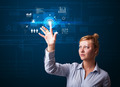 Young business woman touching future web technology buttons and