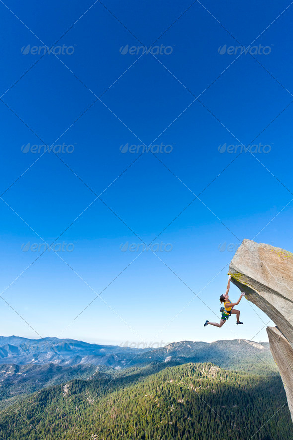Stock Photo - PhotoDune Female rock climber dangling 759671