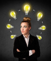 Young woman thinking with lightbulb circulation around her head - PhotoDune Item for Sale