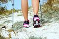 Female feet and trekking stick - PhotoDune Item for Sale