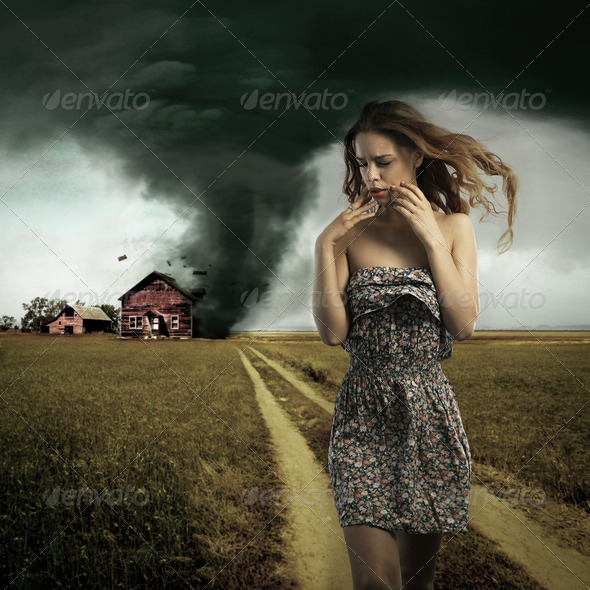 Tornado destroying a woman's house - Stock Photo - Images