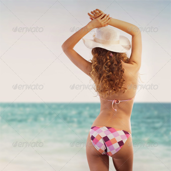 Sexy woman enjoying a day at the beach - Stock Photo - Images