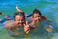Happy swimmers dad and son in the sea - PhotoDune Item for Sale
