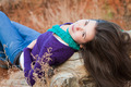 Shot of a young woman lying on log - PhotoDune Item for Sale