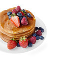 Pancakes with berries and honey over white - PhotoDune Item for Sale