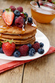 Pancakes with berries and honey closeup - PhotoDune Item for Sale