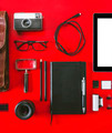 Closeup of different photography objects on red background. - PhotoDune Item for Sale