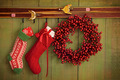 Christmas stockings and wreath hanging on  wall - PhotoDune Item for Sale