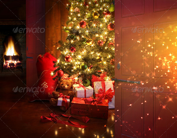 Christmas scene with tree and fire in background - Stock Photo - Images