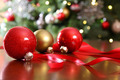 Red Christmas ornaments on a table - PhotoDune Item for Sale