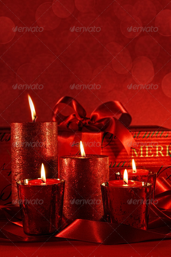 Christmas candles on a red background - Stock Photo - Images
